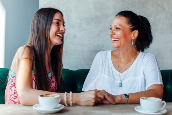 Emotionally Resilient Children, mother and daughter laughing over tea